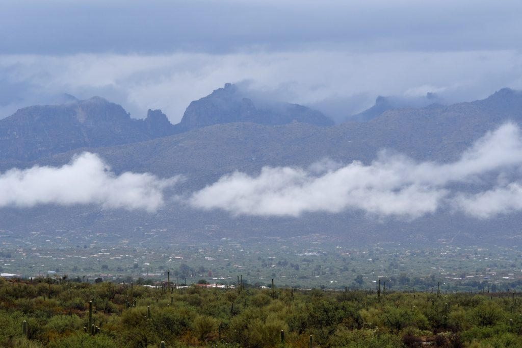 clouds hanging over catalina mountains in tucson arizona