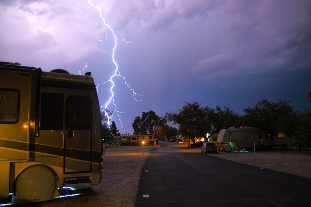 motorhome with a bolt of lightning behind it